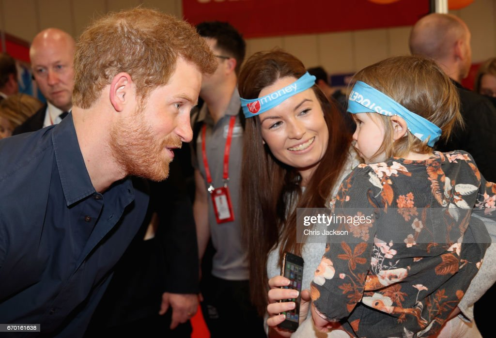 Prince Harry meets a mother and her young child as he officially opens the Virgin Money London Marathon Expo at ExCel on April 19, 2017 in London, England. Prince Harry, who is Patron of the London Marathon Charitable Trust, will meet runners and hand out race numbers, along with special edition 'Heads Together' headbands, which is the official Charity of the Year for this year's marathon.