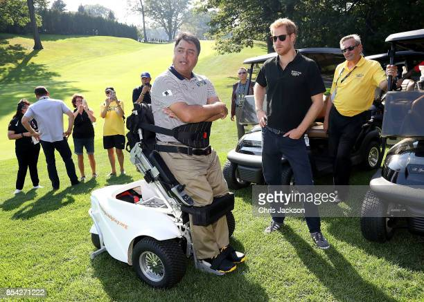 Prince Harry meets Anthony Netto during the Invictus Games 2017 at St George's Golf Club on September 26 2017 in Toronto Canada