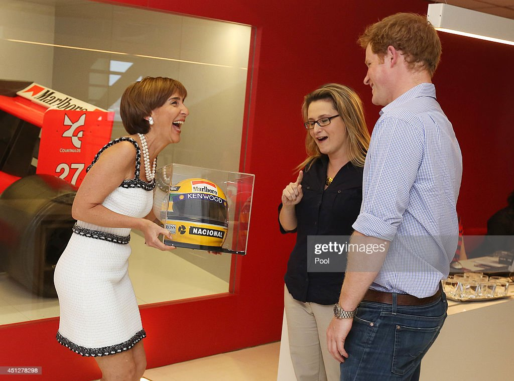 Prince Harry meets Ayrton Senna's sister, Vivienne Senna who presents him with a replica Ayrton Senna helmet at the Ayrton Senna Institue on June 26, 2014 in Sao Paulo Brazil. Prince Harry is on a four day tour of Brazil that will be followed by two days in Chile.
