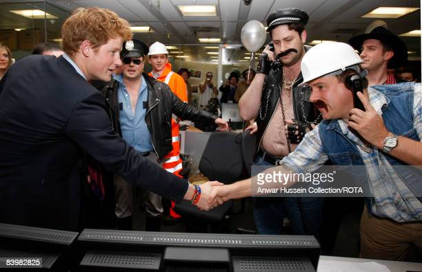 Prince Harry meets brokers at the offices of city traders ICAP on December 10, 2008 in London, England. The Prince attended the 16th ICAP Charity...
