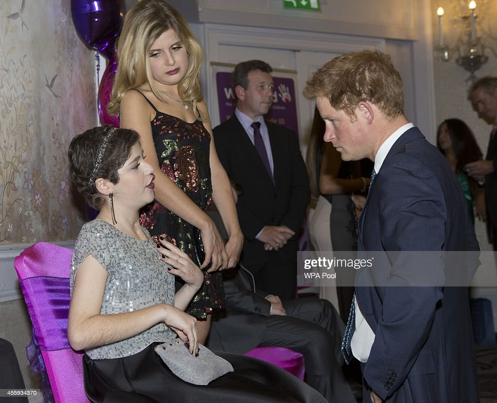 Prince Harry meets Cecilia (Cissy) Adamou (15) , Inspirational young person award winner 12-13, during the WellChild awards at the London Hilton on September 22, 2014 in London, England.