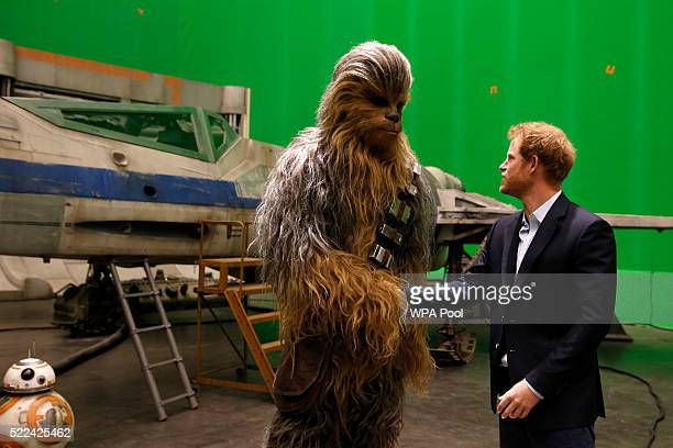 Prince Harry meets Chewbacca during a tour of the Star Wars sets at Pinewood studios on April 19, 2016 in Iver Heath, England. Prince William and...