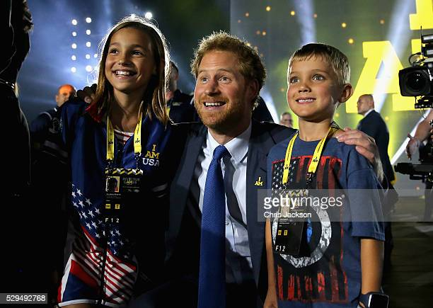 Prince Harry meets children of servicemen and women during the Opening Ceremony of the Invictus Games Orlando 2016 at ESPN Wide World of Sports on...