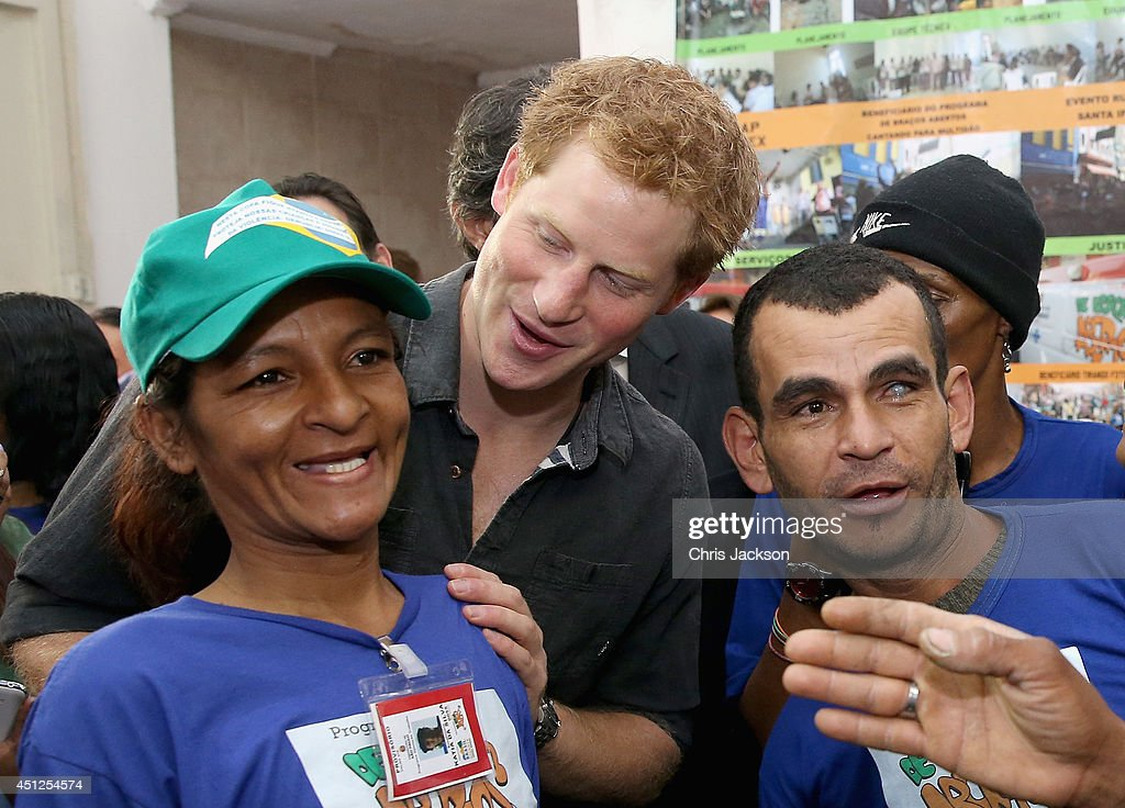 Prince Harry meets crack-addict street cleaners during a visit to 'Cracolandia', an extremely deprived area of Sao Paulo with a high concentration of crack addicts on June 26, 2014 in Sao Paulo Brazil. Crack in Sao Paulo costs just 80 UK pence for a rock of the drug. Prince Harry is on a four day tour of Brazil that will be followed by Two days in Chile.