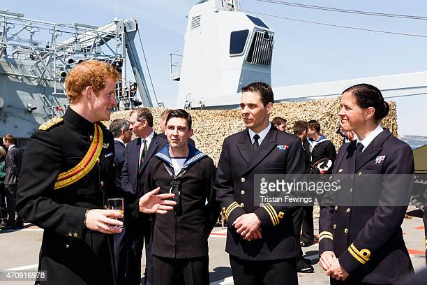 Prince Harry meets crew members on HMS Bulwark at a reception for decendants of the Gallipoli campaign on April 24 2015 in Seddulbahir Turkey Turkish...