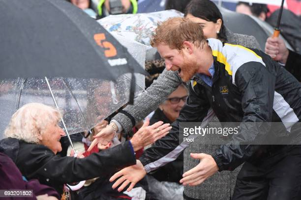 Prince Harry meets Daphne Dunne during a walk around The Rocks on June 7 2017 in Sydney Australia Prince Harry is on a twoday visit to Sydney for the...