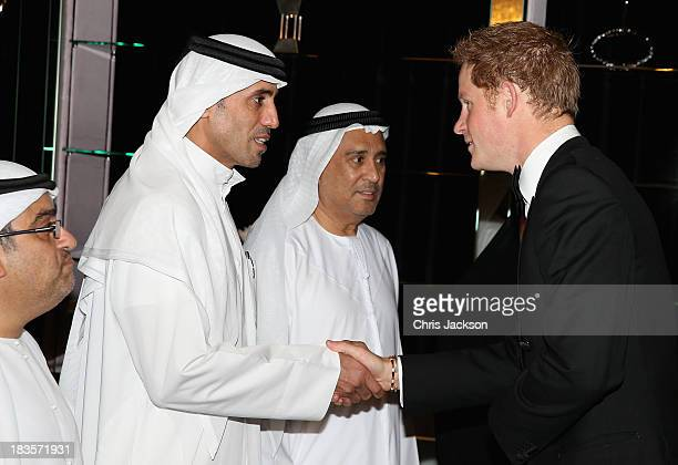 Prince Harry meets guests ahead of the Sentable 'Forget Me Not' dinner on October 7, 2013 in Dubai, United Arab Emirates. The dinner is in...