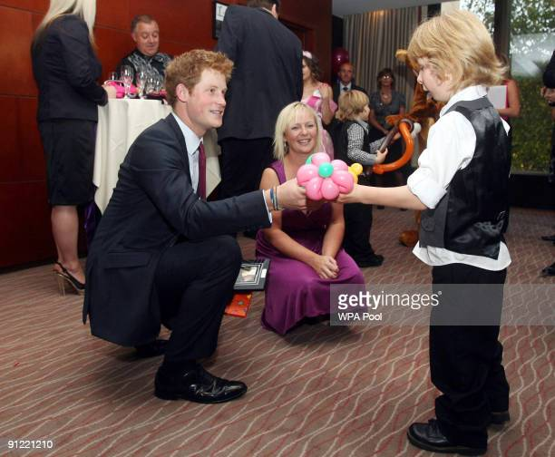 Prince Harry meets Harrison Holmes at the WellChild Awards on September 28 2009 in London England