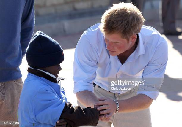 Prince Harry meets HIV affected children at the Mamahato Network Club at King Letsie's Palace on June 17, 2010 in Maseru, Lesotho. The two Princes...