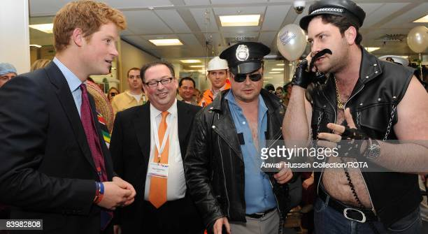 Prince Harry meets Jay Aaronson and fellow brokers at the offices of city traders ICAP on December 10, 2008 in London, England. The Prince attended...