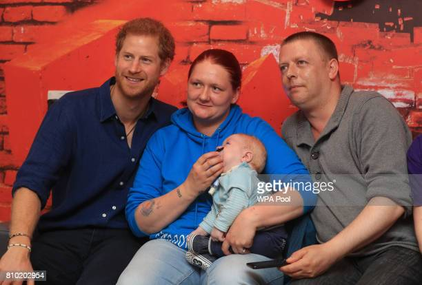 Prince Harry meets Lewis Maloy and his parents KerryAnne Rhodes and Andrew Maloy for a visit to Leeds Children's Hospital during an official visit to...