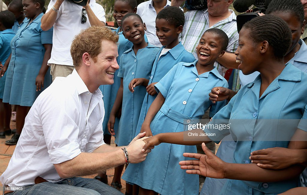 Prince Harry meets meets 15 year old orphan Keneuoe and partially sighted children at St Bernadette's Centre for the blind, a project supported by his charity Sentebale on February 27, 2013 in Maseru, Lesotho. Sentebale is a charity founded by Prince Harry and Prince Seeiso of Lesotho. It helps the most vulnerable children in Lesotho get the support they need to lead healthy and productive lives. Sentebale works with local grassroots organisations to help these children, the victims of extreme poverty and Lesotho's HIV/AIDS epidemic. Cathy Ferrier was appointed as Sentebale's Chief Executive in March 2012 and is spearheading a fundraising initiative to build the Mamohato Centre which will provide psychosocial support for children and young people infected with HIV. Prince Harry is due to pay a visit to Lesotho this week to catch up on his charity's progress and meet key children who will be supported by the charity.