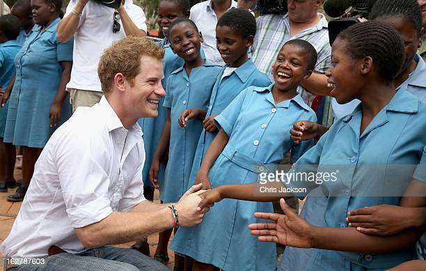 Prince Harry meets meets 15 year old orphan Keneuoe and partially sighted children at St Bernadette's Centre for the blind a project supported by his...