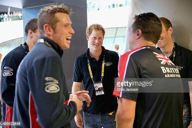 Prince Harry meets members of the British Swimming team at the Aquatics Centre during the Invictus Games at Queen Elizabeth park on September 14 2014...
