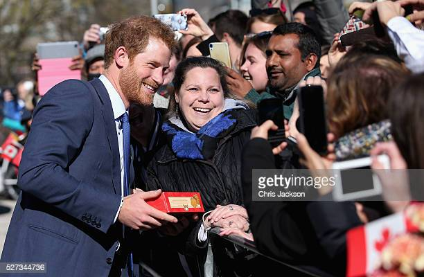 Prince Harry meets members of the public after attending a reception for supporters and organisers of the Invictus Games Toronto at the Office of the...
