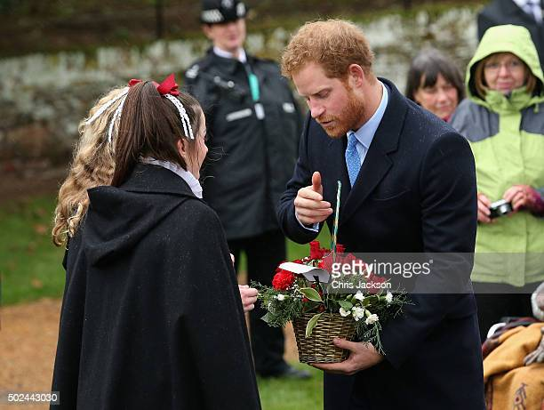 Prince Harry meets members of the public as he attends a Christmas Day church service at Sandringham on December 25 2015 in King's Lynn England