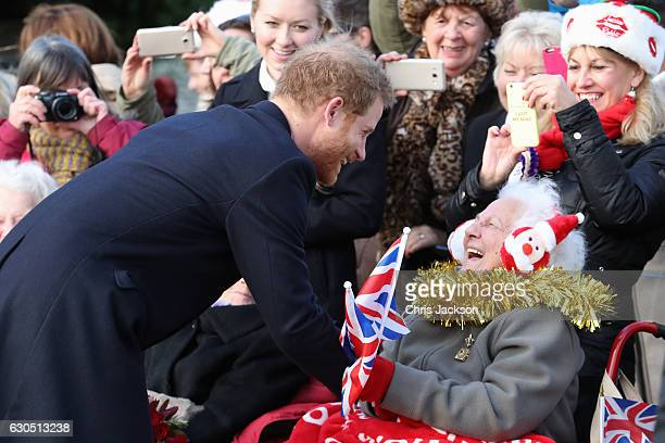 Prince Harry meets members of the public as he attends a Christmas Day church service at Sandringham on December 25 2016 in King's Lynn England