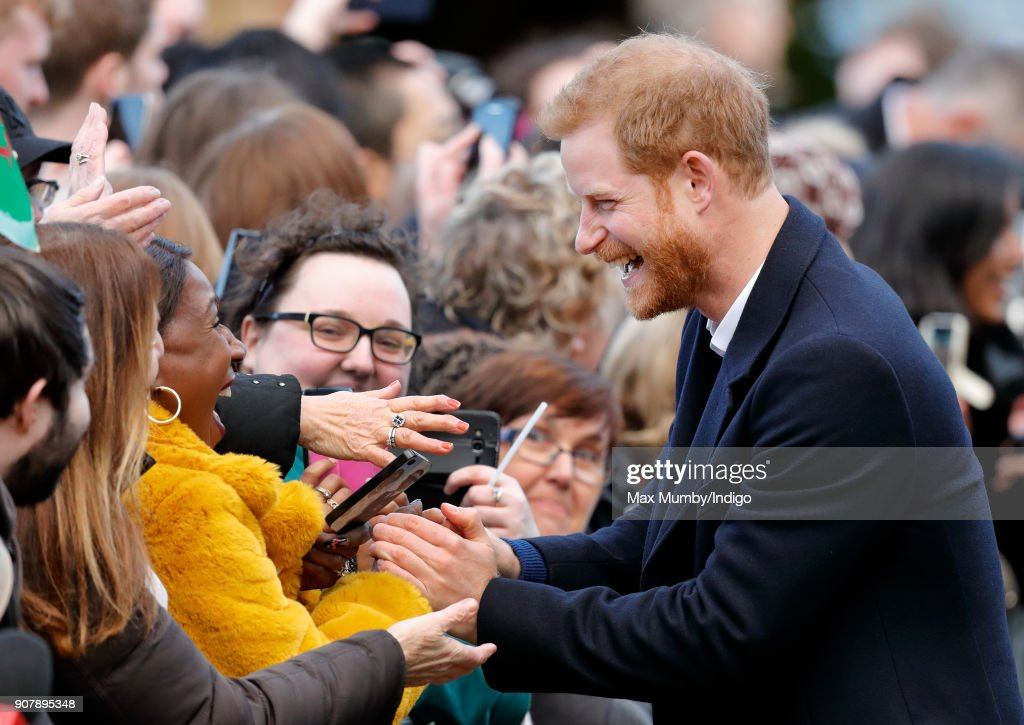 Prince Harry meets members of the public during a walkabout as he visits Cardiff Castle on January 18, 2018 in Cardiff, Wales.