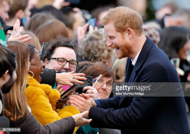 Prince Harry meets members of the public during a walkabout as he visits Cardiff Castle on January 18 2018 in Cardiff Wales