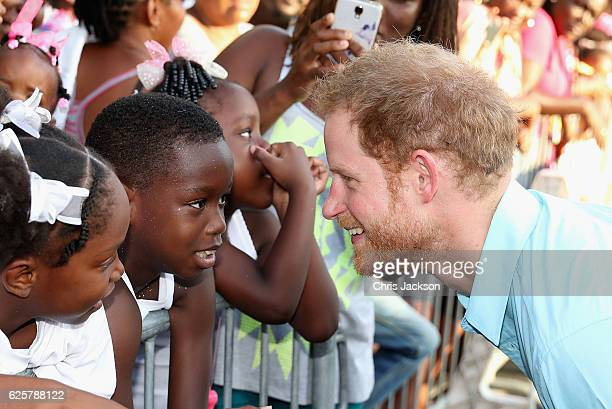 Prince Harry meets members of the public on the sixth day of an official visit on November 25 2016 in Soufriere Saint Lucia Prince Harry's visit to...