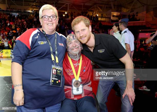 Prince Harry meets Michelle Guest and Paul Guest at the Wheelchair Basketball Finals during the Invictus Games 2017 at Mattamy Athletic Centre on...