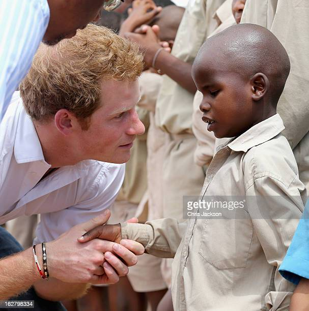 Prince Harry meets partially sighted children at St Bernadette's Centre for the blind a project supported by his charity Sentebale on February 27...