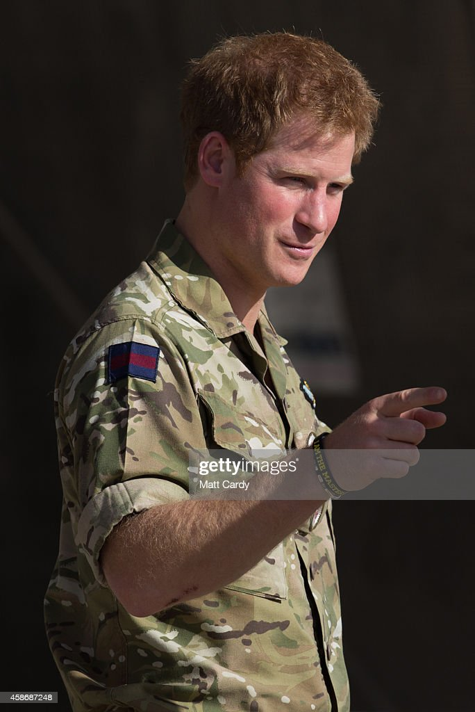 Prince Harry meets pilots and ground crew of a RAF Tornado following a Remembrance Sunday service at Kandahar Airfield November 9, 2014 in Kandahar, Afghanistan. As the the UK combat mission in Afghanistan draws to an end in 2014 this year, which also marks the 100th anniversary of the start of World War One, 70 years since the D-Day landings will be the last time British service personal will gather in any great numbers in the south of the country.
