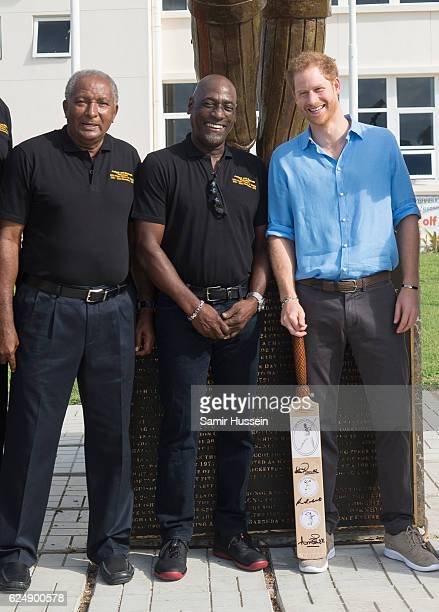 Prince Harry meets Sir Andy Roberts and Sir Vivian Roberts at the Sir Vivian Richards Stadium on the second day of an official visit on November 21...