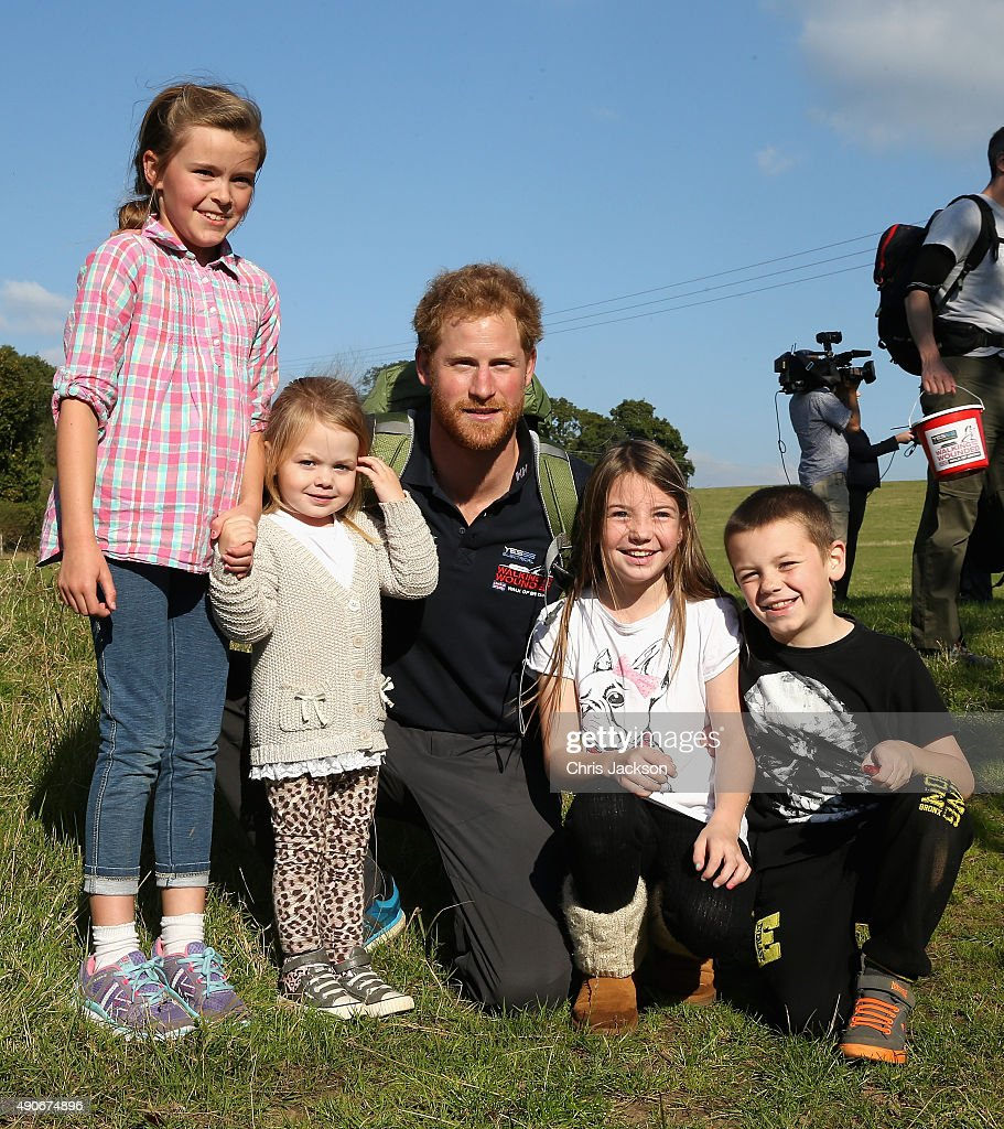 Prince Harry meets some children as he walks the route to Ludlow with Walking with the Wounded's Walk of Britain team on September 30, 2015 in Ludlow, England. Prince Harry is patron of the expedition and walked today as part of the veteran's 1000 mile, 72 day expedition through the UK mainland.
