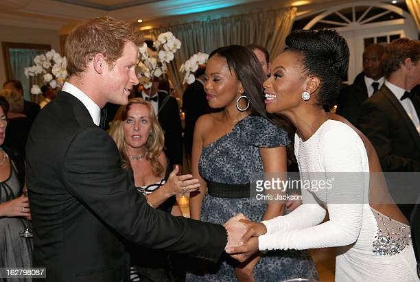 Prince Harry meets South African model Bonang Matheba at the Sentebale Gala Dinner at Summer Place on February 27 2013 in Johannesburg South Africa...