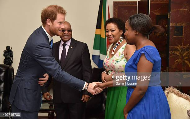 Prince Harry meets South African President Jacob Zuma his wife Mrs Tobeka Madiba Zuma and their daughter Msholozi Zumaat at their home during an...