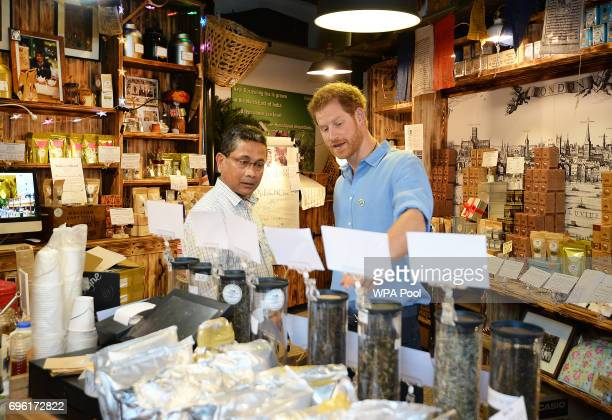 Prince Harry meets stallholder Ratan Mandal in his Tea shop as she tours stalls during a visit to Borough Market which has opened yesterday for the...