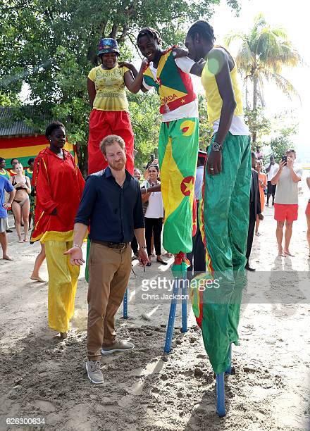 Prince Harry meets stilt walkers on the eighth day of an official visit to Grand Anse Beach on November 28 2016 in Grenada Prince Harry's visit to...