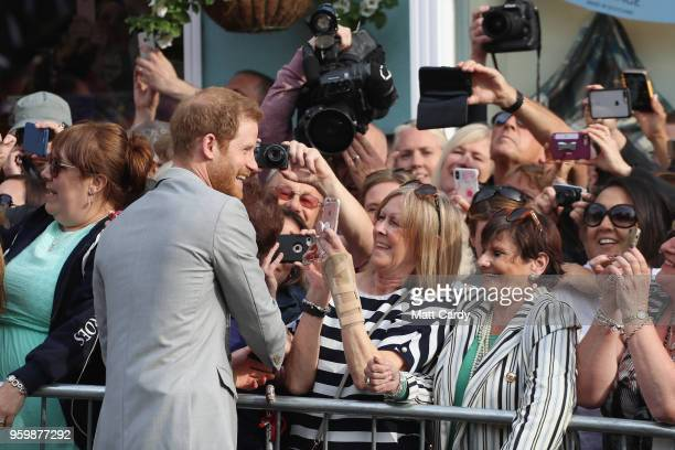Prince Harry meets the public during a pre wedding walkabout ahead of his wedding to Meghan Markle on May 18 2018 in Windsor England
