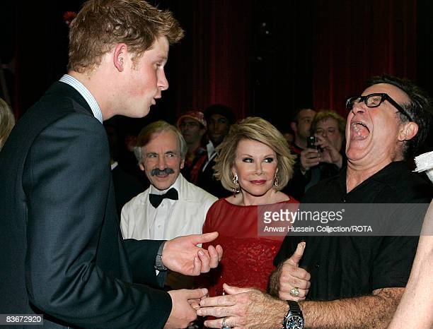 Prince Harry meets US actor Robin Williams backstage at the Wimbledon Theatre after a charity performance in aid of the Prince's Trust on November 12...