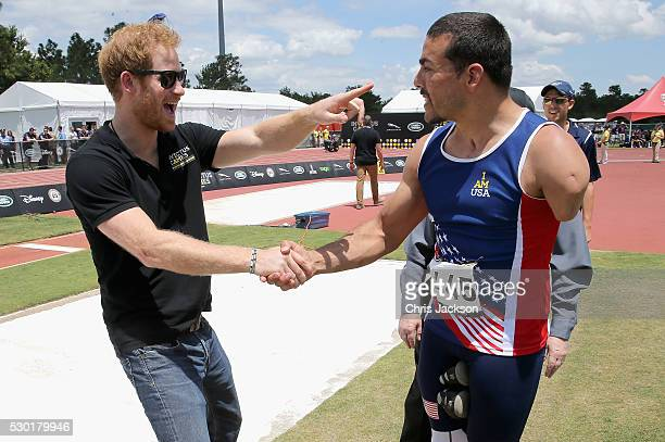 Prince Harry meets US athlete Michael Kacer the track and field events from the crowd during the Invictus Games Orlando 2016 at ESPN Wide World of...