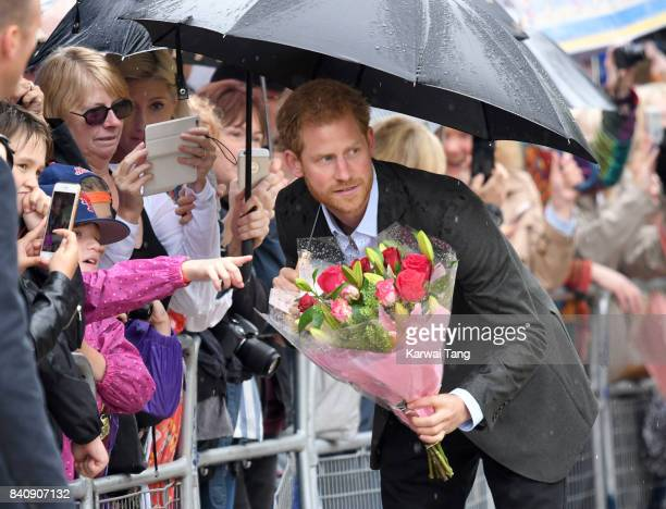 Prince Harry meets well wishers and views tributes to Princeess Diana after a visit to The Sunken Garden at Kensington Palace on August 30 2017 in...