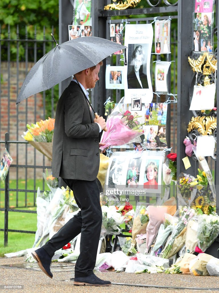 Prince Harry meets well wishers and views tributes to Princeess Diana after a visit to The Sunken Garden at Kensington Palace on August 30, 2017 in London, England. The garden has been transformed into a White Garden dedicated in the memory of Princess Diana, mother of Prince WIlliam, Duke of Cambridge and Prince Harry.