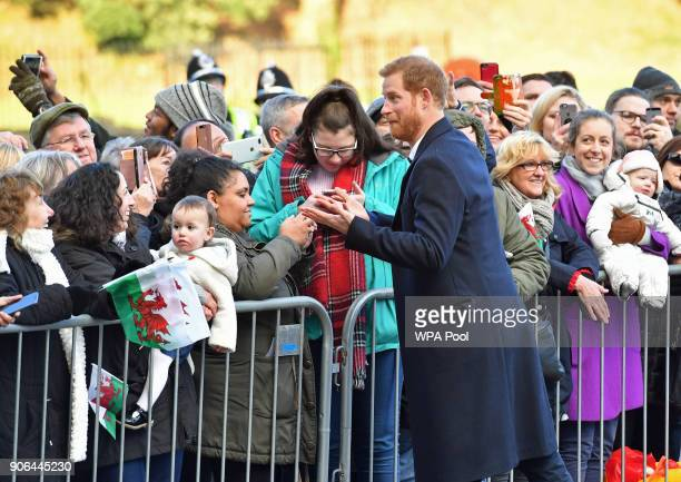 Prince Harry meets well wishers as he arrives to a walkabout at Cardiff Castle on January 18 2018 in Cardiff Wales