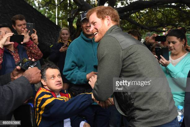 Prince Harry meets with members of the public as he arrives for a venue tour of the Sydney International Aquatic Centre June 8 2017 in Sydney...