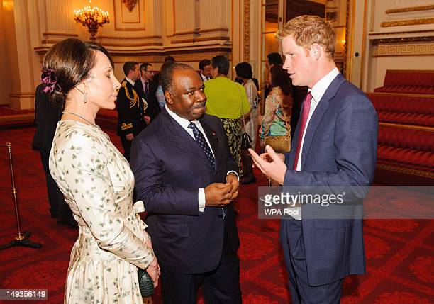 Prince Harry meets with the President of Gabon Ali Bongo Ondimba and his wife Sylvia during a reception at Buckingham Palace a reception for Heads of...
