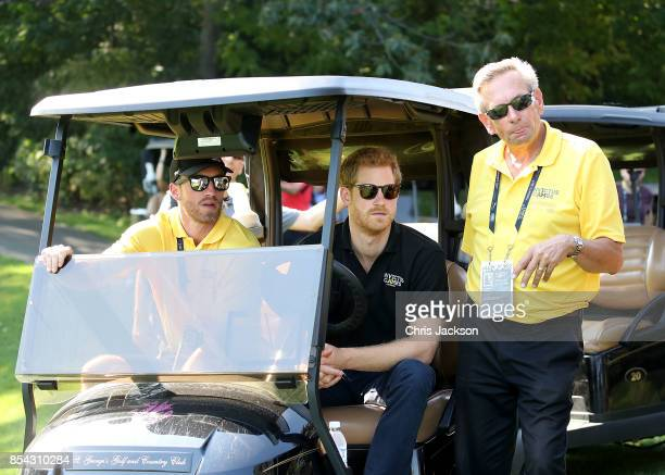 Prince Harry observes the Golf during the Invictus Games 2017 at St George's Golf Club on September 26 2017 in Toronto Canada