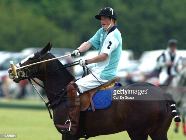 Prince Harry of England plays polo at the Cirencester Park Polo Club against Cheltenham College May 10 2003 in Cirencester England