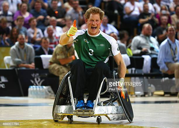 Prince Harry of Invictus celebrates during the Jaguar Land Rover Exhibition Wheelchair Rugby Match during day 2 of the Invictus Games presented by...