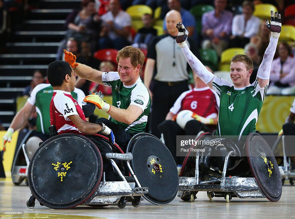Prince Harry of Invictus celebrates victory with James Roberts (R) after the Jaguar Land Rover Exhibition Wheelchair Rugby Match during day 2 of the Invictus Games, presented by Jaguar Land Rover at the Copper Box Arena on September 12, 2014 in London, England.
