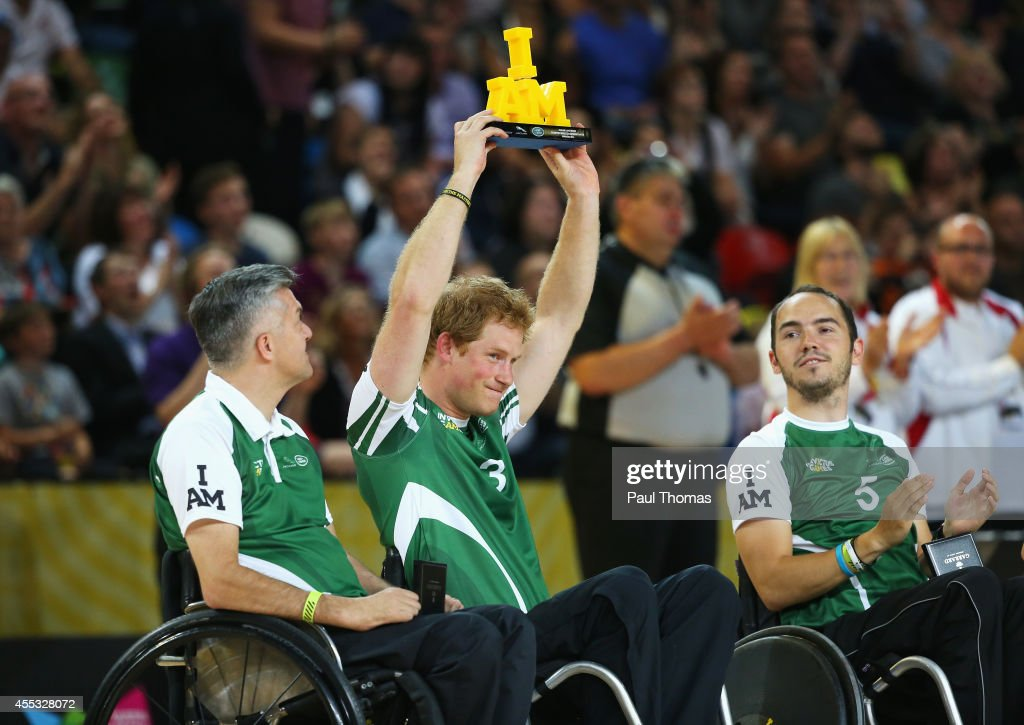 Prince Harry of Invictus holds the winners trophy after the Jaguar Land Rover Exhibition Wheelchair Rugby Match during day 2 of the Invictus Games, presented by Jaguar Land Rover at the Copper Box Arena on September 12, 2014 in London, England.