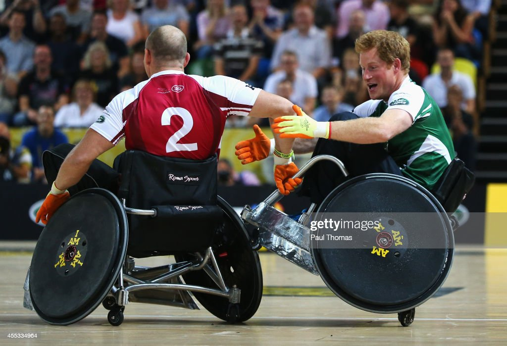 Prince Harry of Invictus is challenged by Mike Tindall of Endeavour during the Jaguar Land Rover Exhibition Wheelchair Rugby Match during day 2 of the Invictus Games, presented by Jaguar Land Rover at the Copper Box Arena on September 12, 2014 in London, England.