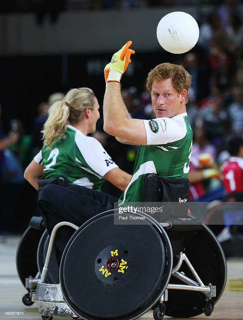 Prince Harry of Invictus passes during the Jaguar Land Rover Exhibition Wheelchair Rugby Match during day 2 of the Invictus Games, presented by Jaguar Land Rover at the Copper Box Arena on September 12, 2014 in London, England.