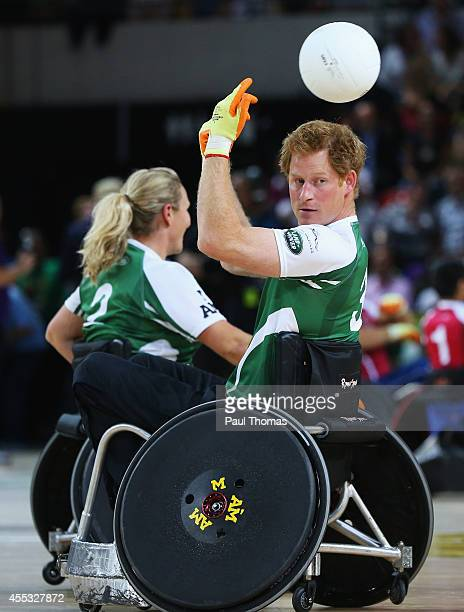 Prince Harry of Invictus passes during the Jaguar Land Rover Exhibition Wheelchair Rugby Match during day 2 of the Invictus Games presented by Jaguar...