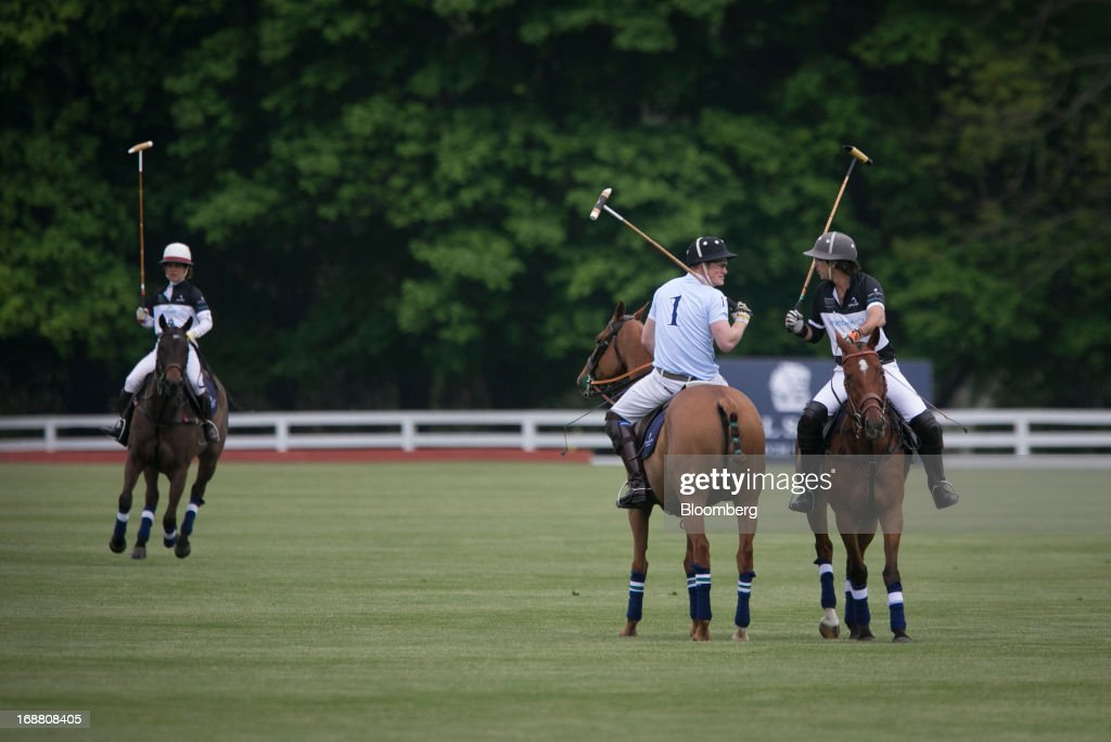 Prince Harry of Wales, center, plays polo during the Sentebale Royal Salute Polo Cup at the Greenwich Polo Club in Greenwich, Connecticut, U.S., on Wednesday, May 15, 2013. Prince Harry's visit is part of a week-long U.S. tour that also includes stops in Washington, Colorado and New York. Photographer: Scott Eells/Bloomberg via Getty Images